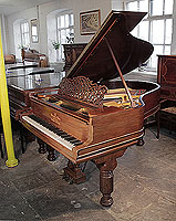 An 1895, Steinway Model A grand piano for sale with a rosewood case, filigree music desk and fluted, barrel legs. Piano has an eighty-five note keyboard and a three-pedal lyre.