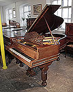 An 1895, Steinway Model A grand piano for sale with a rosewood case, filigree music desk and fluted, barrel legs. Piano has an eighty-five note keyboard and a three-pedal lyre. .