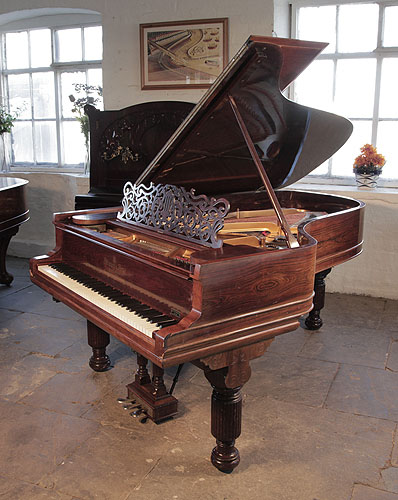 An 1896, Steinway Model B grand piano for sale with a rosewood case, filigree music desk and fluted, barrel legs