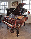 An 1896, Steinway Model B grand piano for sale with a rosewood case, filigree music desk and fluted, barrel legs. Piano has a three-pedal lyre and an eighty-five note keyboard.