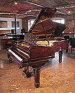 Restored, 1899, Steinway Model B grand piano for sale with a rosewood case, filigree music desk and fluted, barrel legs