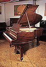 A 1930, Steinway Model M Grand Piano For Sale with a Polished, Mahogany Case and Spade Legs Piano has an eighty-eight note keyboard and a two-pedal lyre.