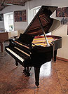 Piano for sale. A 1978, Steinway Model O grand piano with a black case and spade legs. Piano has an eighty-eight note keyboard and a two-pedal lyre.