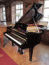 A rebuilt, 1914, Steinway Model O grand piano for sale with a black case and spade legs. Piano has an eighty-eight note keyboard and a two-pedal lyre.