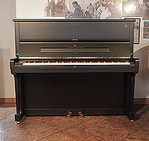 A 1998, Steinway Model V upright piano with a satin, black case and brass fittings