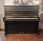 Piano for sale. A 1998, Steinway Model V upright piano with a satin, black case and brass fittings
