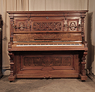 Piano for sale. Neoclassical style, Steinweg Nachf upright piano for sale with a carved, walnut case and ornate candlesticks. Cabinet features a front panel carved with cabuchons, and c-scrolls in high relief