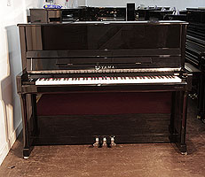 A Toyama Upright Piano For Sale with a Black Case and Chrome Fittings