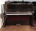 Piano for sale. Toyama Upright Piano For Sale with a Black Case and Chrome Fittings. Piano has an eighty-eight note keyboard and three pedals.
