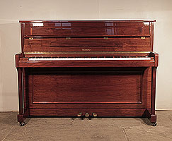 Wesberg U-112R upright piano for sale with a walnut case and polyester finish . Piano has an eighty-eight note keyboard and and three pedals