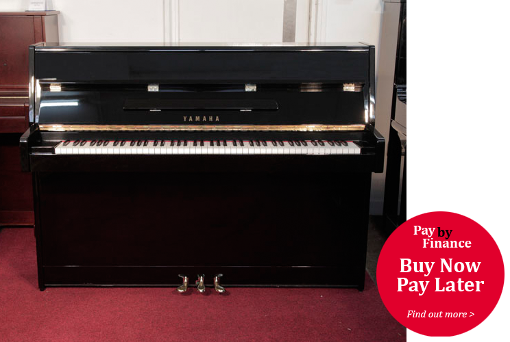 Yamaha  C110A upright piano for sale with a black case and brass fittings