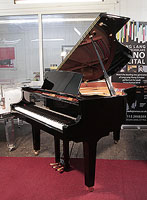 A 2012, Yamaha C2 grand piano for sale with a black case and square legs.