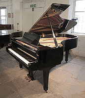 A 1979, Yamaha C7 concert grand piano for sale with a black case and spade legs.