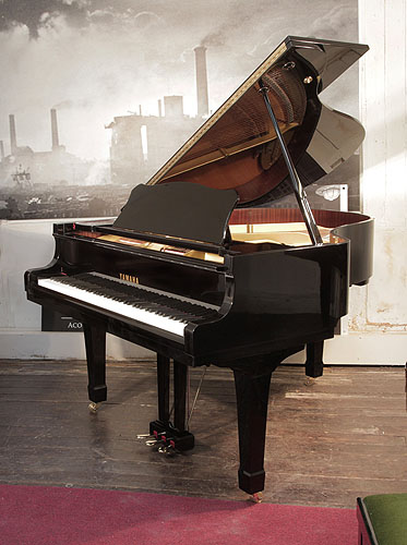 Yamaha G2 grand piano for sale with a black case and polyester finish.