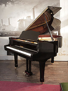 A 1989, Yamaha G2 grand piano for sale with a black case and spade legs. Piano has an eighty-eight note keyboard and a three-pedal lyre..