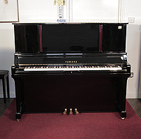 A 2001, Yamaha U5 Upright piano for sale with a black case and mahogany accent detail. Cabinet features an extended, pull-out music desk and a slow fall mechanism. Piano has an eighty-eight note keyboard and three pedals.