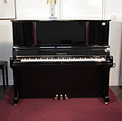 Piano for sale.A 2001, Yamaha U5 Upright piano for sale with a black case and mahogany accent detail. Cabinet features an extended, pull-out music desk and a slow fall mechanism. Piano has an eighty-eight note keyboard and three pedals.