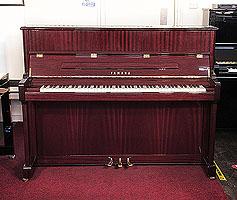 A 2006, Yamaha V118 upright piano with a mahogany case and polyester finish