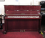 Piano for sale.  A 2006, Yamaha V118 upright piano with a mahogany case and polyester finish. Piano has an eighty-eight note keyboard and three pedals.