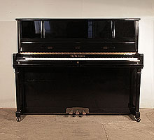 Young Chang E-118 Upright Piano For Sale with a Black Case and Brass Fittings. Piano has an eighty-eight note keyboard and three pedals.