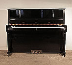 Piano for sale. A Young Chang E-118  upright piano for sale with a black case and brass fittings
