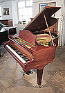 A reconditioned, 1930's Bechstein Model K grand piano with a polished, mahogany case and square, tapered legs
