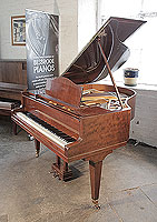 A 1938, Bluthner grand piano for sale with a fiddleback mahogany case and square, tapered legs