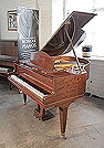 Piano for sale. A 1938, Bluthner grand piano for sale with a fiddleback mahogany case and square, tapered legs