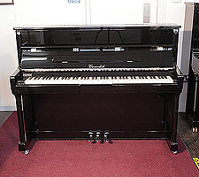 A  Cavendish upright piano with a black case and chrome fittings