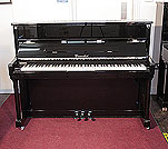 Piano for sale.  Cavendish upright piano with a black case and chrome fittings