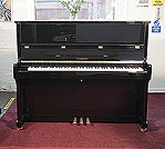 Piano for sale. A brand new, Feurich Model 122 upright piano with a black case and brass fittings