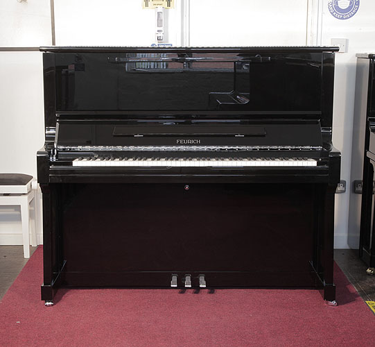Brand New, Feurich Model 122 upright Piano for sale with a black case and chrome fittings.