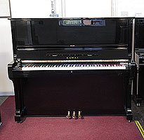 A 1976, Kawai BL-61 upright piano with a black case and polyester finish