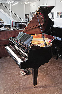 A  Kawai GL-10 baby grand piano for sale with a black case and square, tapered legs..  Piano has an eighty-eight note keyboard and a three-pedal lyre.