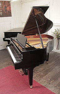 A  Kawai GM-10K baby grand piano for sale with a black case and square, tapered legs..  Piano has an eighty-eight note keyboard and a three-pedal lyre.