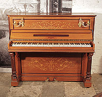 An 1893, Pleyel upright piano with a satinwood case, brass candlesicks and fluted, column legs. Entire cabinet features intricate, Neocalssical style inlay of scrolling acanthus, flowers and foliage in a variety of woods