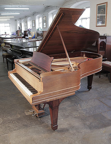 Steinway Model B grand piano for sale with a rosewood case  and spade legs