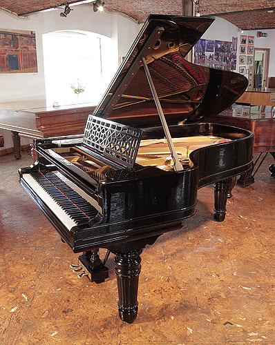 An 1898, Steinway Model B Grand piano for sale with a black case, cut-out music desk in a geometric design and fluted, barrel legs