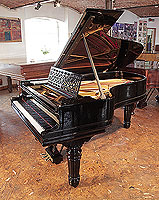 Steinway Model B grand piano for sale with a black case, cut-out music desk in a geometric design and fluted, barrel legs