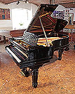 Piano for sale. Steinway Model B grand piano for sale with a black case, cut-out music desk in a geometric design and fluted, barrel legs