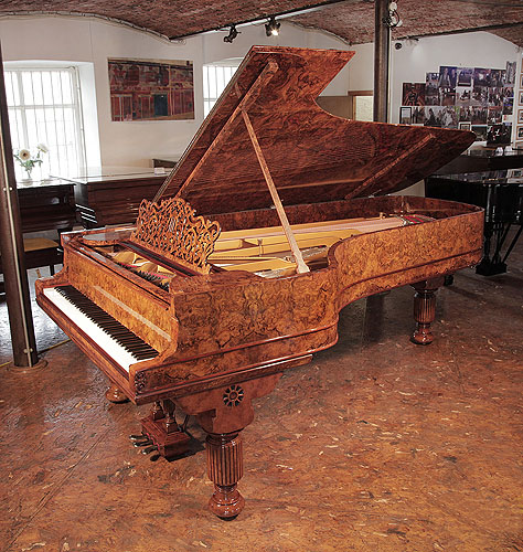 An 1881, Steinway & Sons Model D concert grand piano with a burr walnut case, filigree music desk and fluted, barrel legs