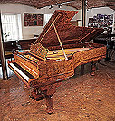 Piano for sale. An 1880, Steinway & Sons Model D concert grand piano with a burr walnut case, filigree music desk and fluted, barrel legs.