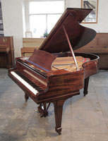 A 1928, Steinway Model M Grand Piano For Sale with a Polished, Mahogany Case and Spade Legs