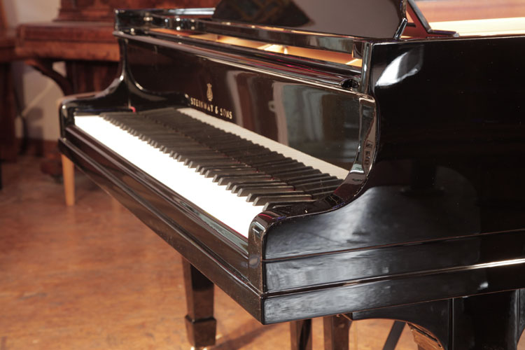 Steinway  model M piano cheek detail. We are looking for Steinway pianos any age or condition.
