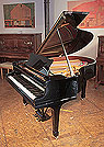 Piano for sale. A 1928, Steinway Model M grand piano for sale with a black case and spade legs