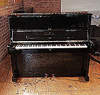 Piano for sale. A 1986, Steinway Model V upright piano with a black case and brass fittings. Piano has an eighty-eight note keyboard and two pedals