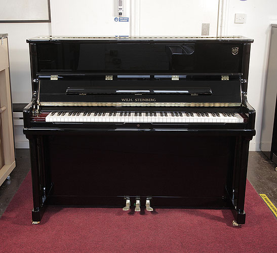Brand New, Wilh. Steinberg Model AT-K23  upright Piano for sale with a black case.