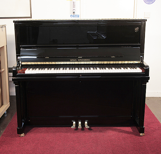 Brand New, Steinberg Model AT-K30  upright Piano for sale with a black case and slow fall mechanism. Cabinet features a walnut key block