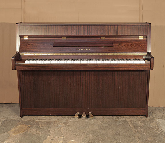 A 1995,  Yamaha  C108N Upright Piano For Sale with a  Mahogany Case and Brass Fittings.