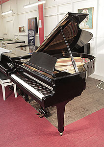 A 1979, Yamaha C3 conservatory grand piano for sale with a black case and spade legs. Piano has an eighty-eight note keyboard and a two-pedal lyre.